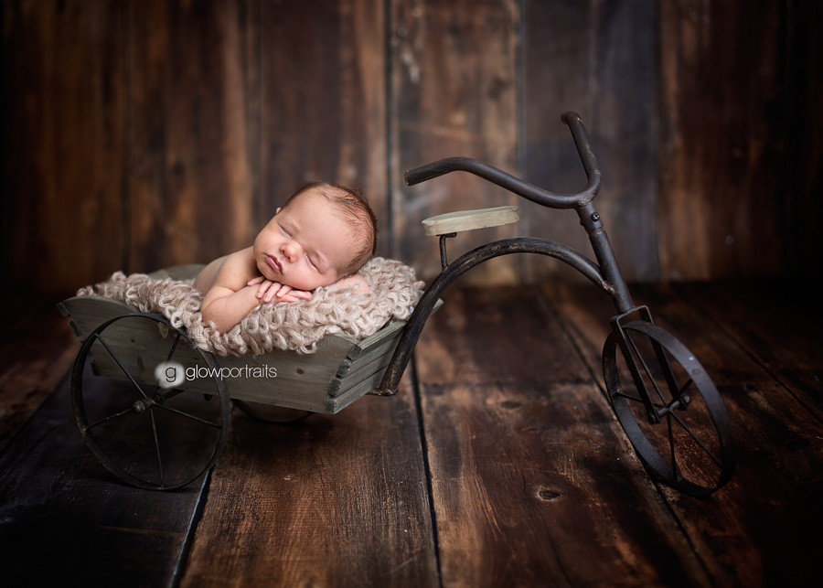 newborn in bike prop, photography props