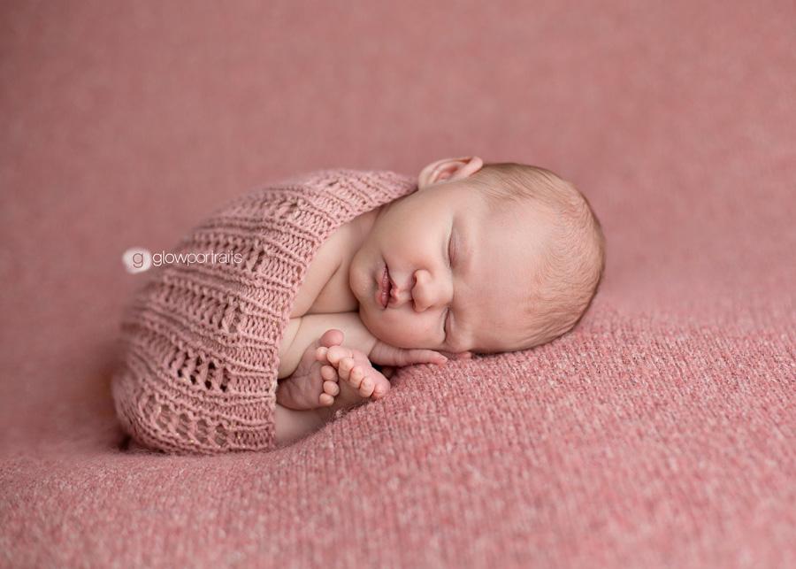 newborn wrap on blanket
