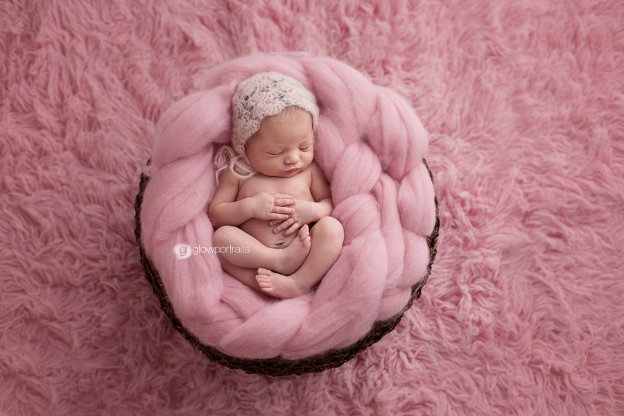 newborn baby girl on fur
