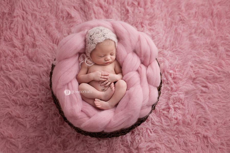 newborn baby girl on fur