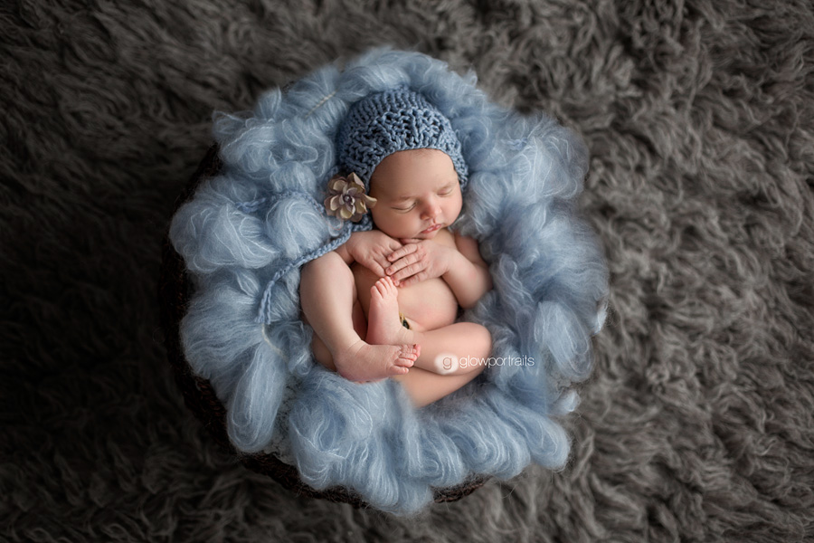newborn on fur rug