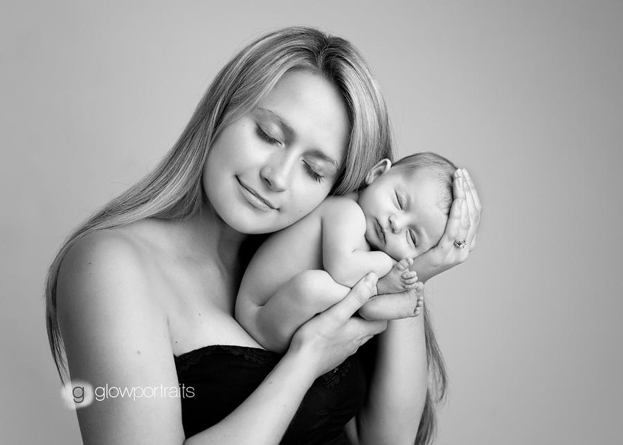 black and white image of mom holding newborn girl
