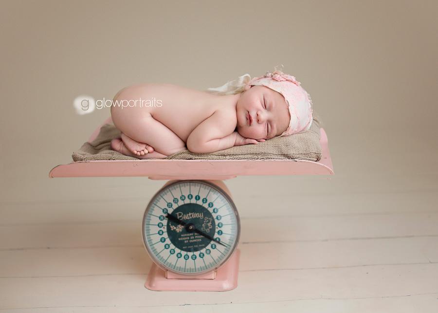 newborn baby on scale