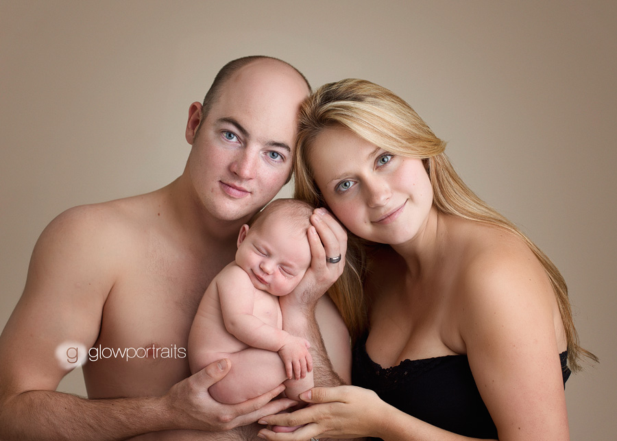 newborn posing with mom and dad