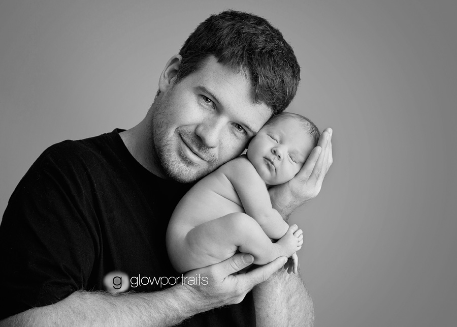 Dad holding newborn baby daddy snuggle newborn baby photograph