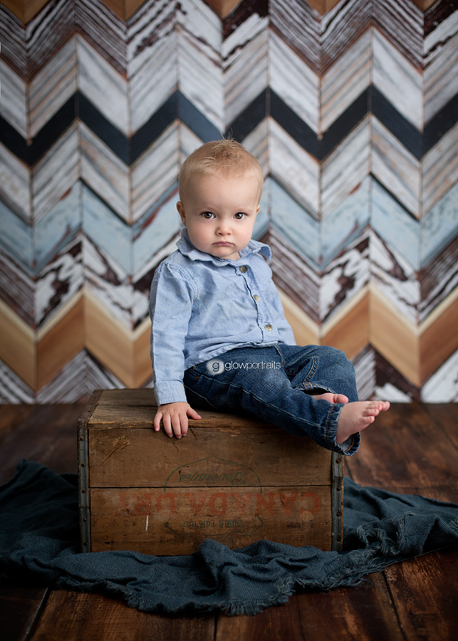 baby sitting on box chevron backdrop