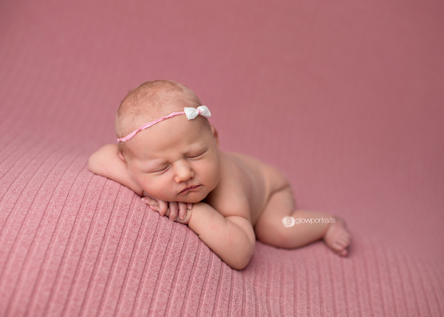 newborn baby girl on beanbag pose