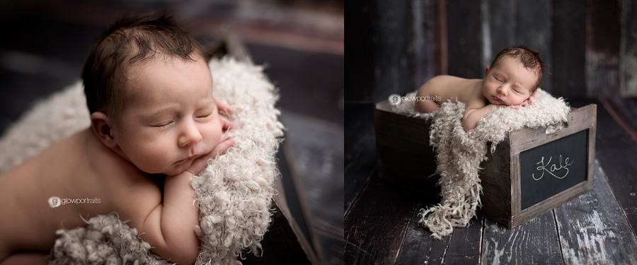 baby boy in box with name in chalk