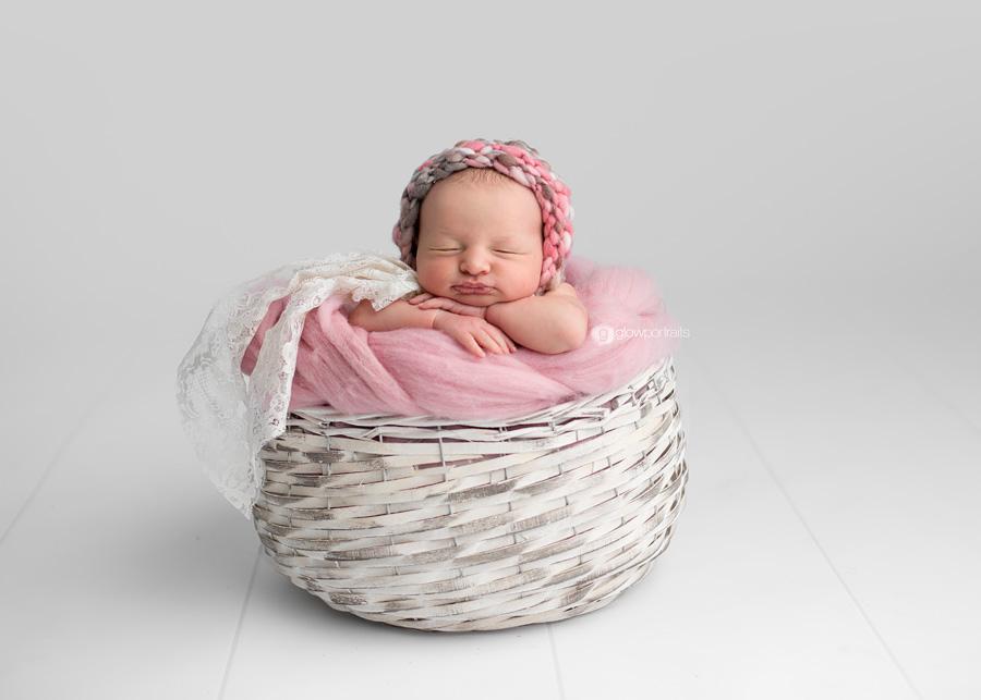 baby girl in white basket