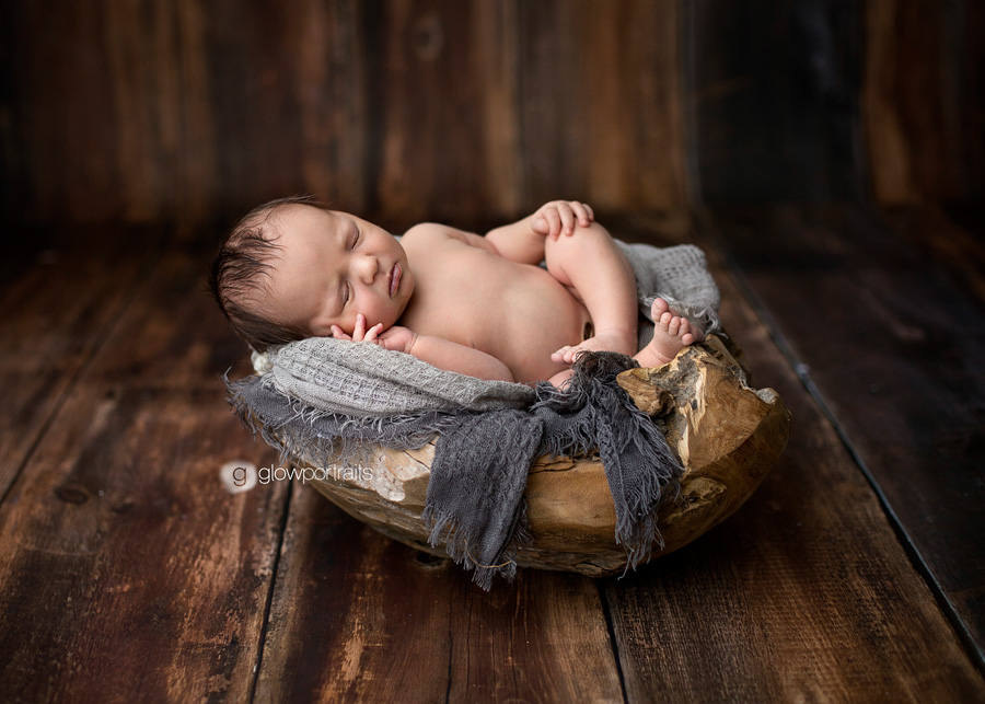 baby in wooden bowl
