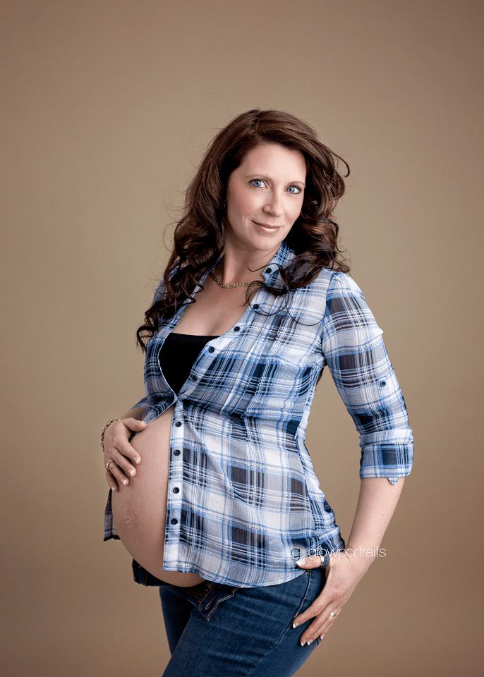 maternity session lady wearing plaid shirt