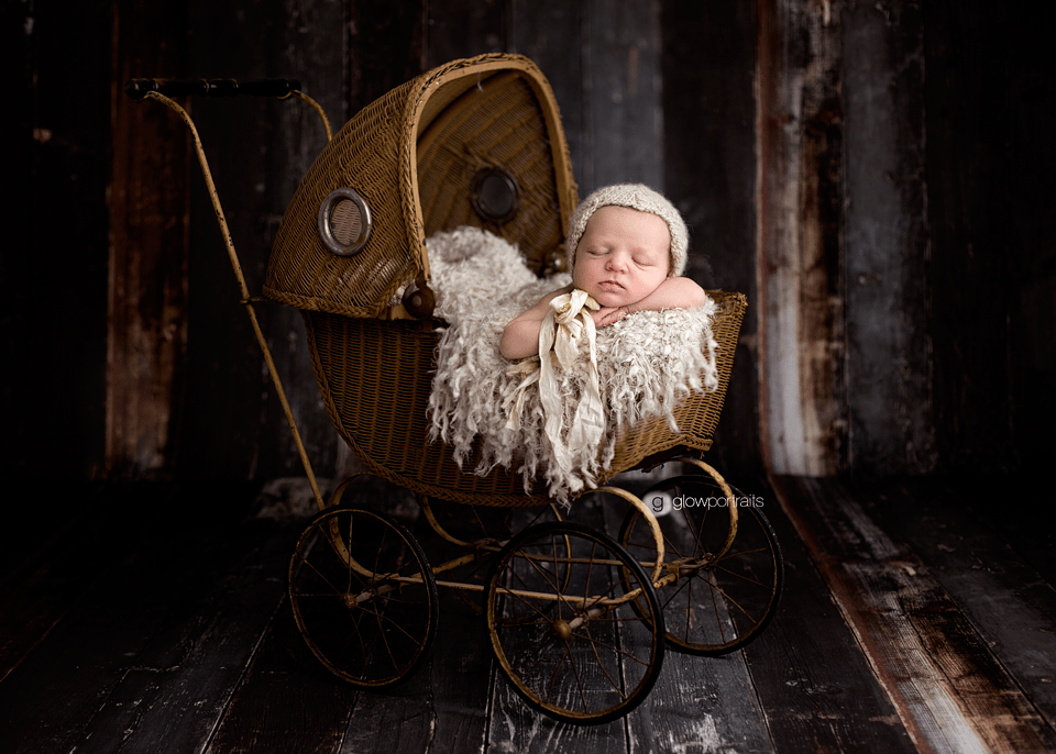 newborn baby in baby carriage